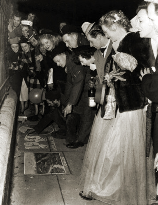 New Year revellers, London's West End are admiring the work of a pavement artist 1953
