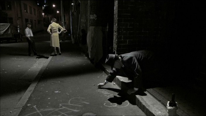 Movie Still: Arthur Stace chalks outside the brothels of Sydney