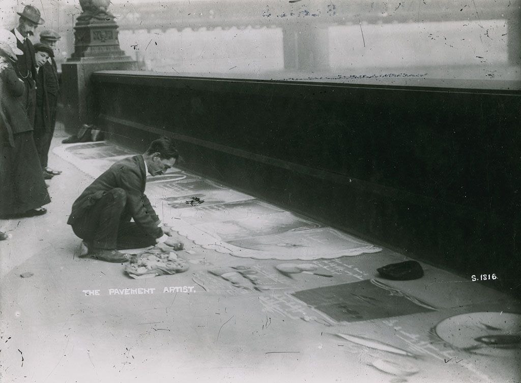 Pavement artist on the Thames Embankment, London. Cir. 1915