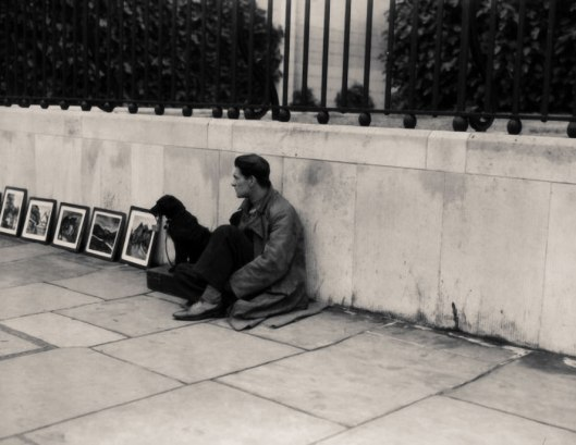 London street-artist (Boardman) with dog 1935.